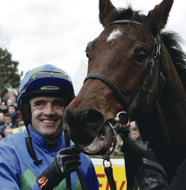 Jockey Ruby Walsh with Hurricane Fly after winning the Ryanair Hurdle at Leopardstown's Christmas Festival