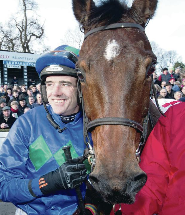 Ruby Walsh and Hurricane Fly celebrate at Leopardstown