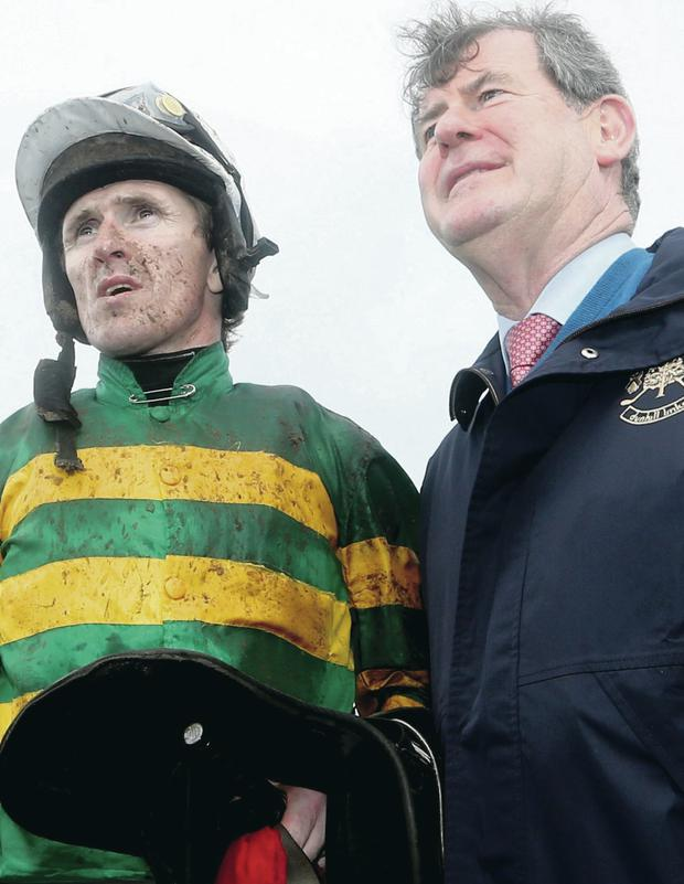 Grand plan: Tony McCoy and owner JP McManus are out to repeat 2010 Grand National success