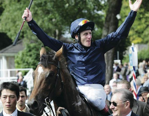 Winner alright: Johnny Murtagh celebrates Juddmonte International victory on Rip Van Winkle, one of many big-race wins for the Meath man PA