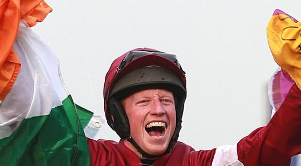 Jockey Mikey Fogarty celebrates on board Don Poli after winning the Martin Pipe Conditional Jockeys' Handicap Hurdle on Gold Cup Day, during the Cheltenham Festival.