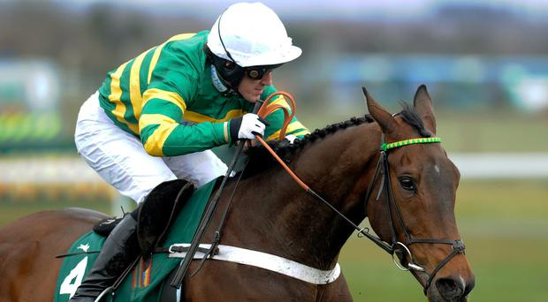 LIVERPOOL, ENGLAND - APRIL 05: Tony McCoy riding My Tent Or Yours clear the last to win the Rose Appeal Supports Alder Hey Top Novices' Hurdle Race at Aintree racecourse on April 05, 2013 in Liverpool, England. (Photo by Alan Crowhurst/Getty Images)