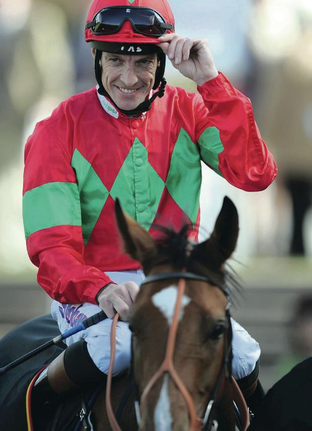 Ready to rock: Champion jockey Richard Hughes suffered broken back 12 days ago but aims to be back riding this month