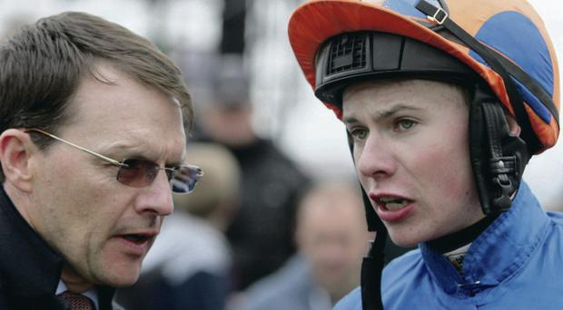 Trainer Aidan O'Brien with his son, jockey Joseph O'Brien, after ridding Magician to victory at Curragh Racecourse