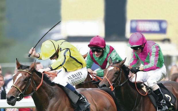 Out in front: Ryan Moore drives Rizeena (left) to victory in the Coronation Stakes at Royal Ascot yesterday