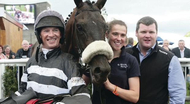 Winning team: jockey Paul Carberry, stable girl Emma Flynn and trainer Gordon Elliot with victorious Swantykay