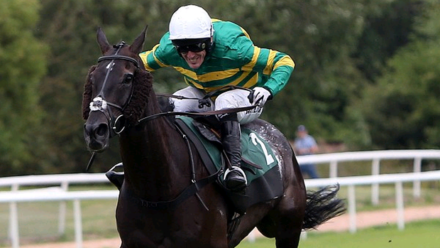 On The Record and Tony McCoy, left, on their way to a record-equalling success