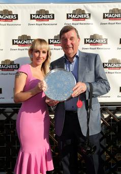 Joe Keeling, Chairman of Horse Racing Ireland receives the winning plate from Sarah Shimmons from Magners