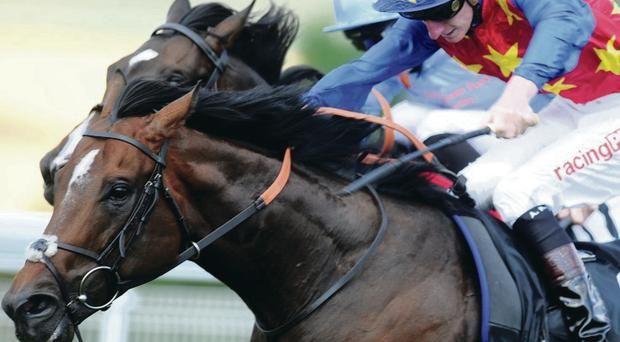 Whip hand: Es Que Love (right), ridden by Adam Kirby, on the way to winning the feature bet365 Lennox Stakes at Glorious Goodwood yesterday ahead of Toormore
