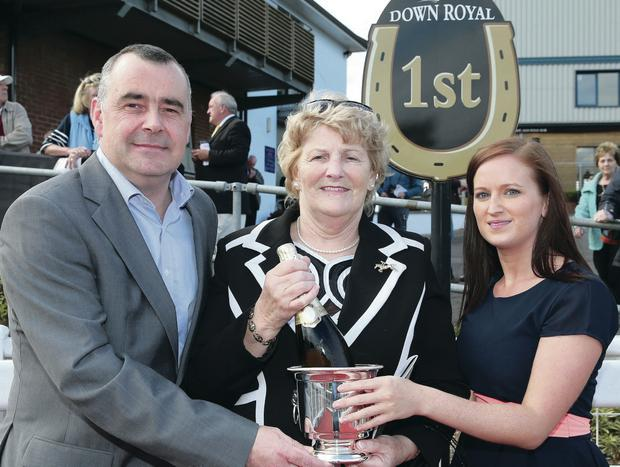 Pires scores: Trevor Magill, Mace Sales Director, Musgrave Retail Partners, and Katrina O'Halloran, Kerry Foods, make winners' presentation to Elizabeth Lawlor, owner of Pires at Down Royal last night