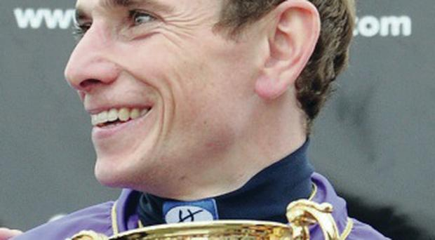 Cup of cheer: Ryan Moore after winning on Estimate yesterday