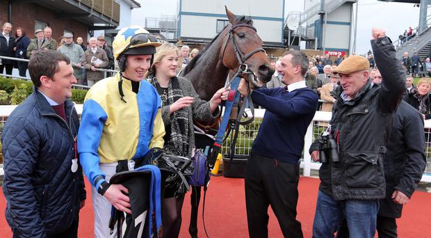 King rules: Little King Robin's jockey Mark Walsh and connections celebrate after victory in the Down Royal Festival's opening day feature, the WKD Hurdle