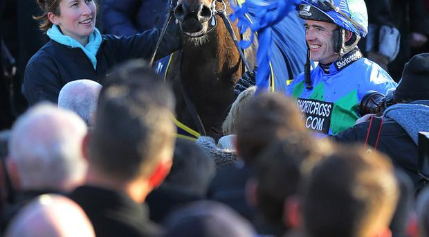 You champion: Ruby Walsh and Hurricane Fly in the parade ring after yesterday's triumph