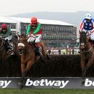 Special Tiara (right) jumps alongside eventual winner Dodging Bullets (centre) in the Queen Mother Champion Chase
