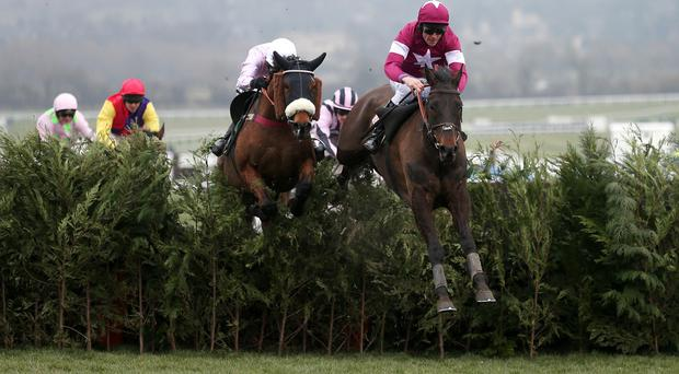 Rivage D'Or ridden by Davy Russell (right) jumps clear and goes on to win the Glenfarclas Handicap Chase on the cross-country course