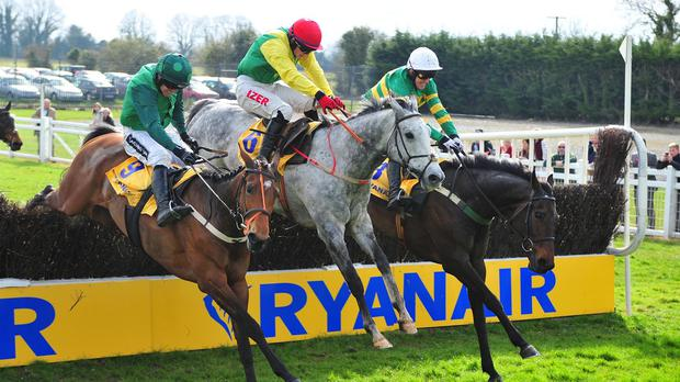 Gilgamboa (right) jumps the last alongside Gitane Du Berlais and the grey Smashing
