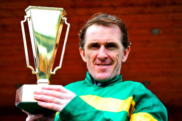 Golden boy: Tony McCoy with the Gold Cup yesterday after victory on Gilgamboa, the second leg of a Fairyhouse double