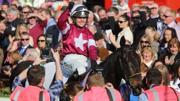 Katie Walsh celebrates after guiding Thunder And Roses to victory in the BoyleSports Irish Grand National at Fairyhouse