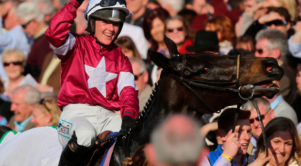 Victory wave: Katie Walsh enters the winners' enclosure on Thunder and Roses