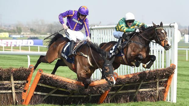 Arctic Fire (left) falls as Jezki clears the final flight to win the Doom Bar Aintree Hurdle