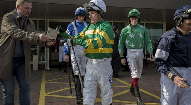 Write stuff: Tony McCoy signs an autograph ahead of his last ever race at Cheltenham, his mount Milan Bound going on to finish seventh in the Barbury International Supporting IJF Handicap