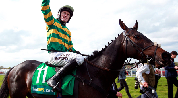 A life less ordinary: Tony McCoy salutes the 18,000 capacity crowd at Sandown after riding the aptly named Box Office in his final race