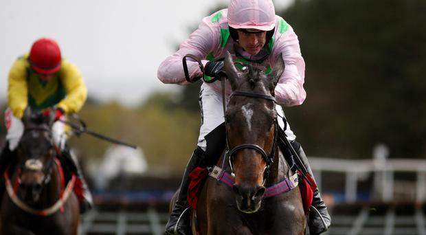 Out in front: Ruby Walsh steers Douvan to victory in Champion Novice Hurdle on the opening day of the Punchestown Festival