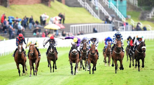 Trip To Paris (left) swoops widest of all to lift the Chester Cup