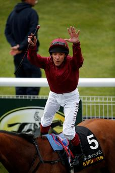 Jump to it: Frankie Dettori celebrates victory on Star Of Seville in the Musidora Stakes at York's Dante Festival