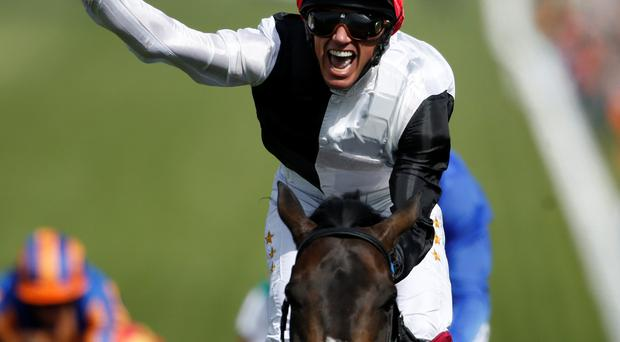 Funtime: Frankie Dettori celebrates after riding Golden Horn to victory in the Derby at Epsom