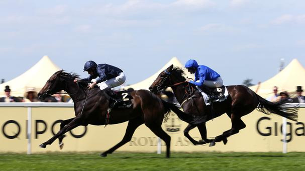 Curvy ridden by Ryan Moore (left) on her way to winning the Ribblesdale Stakes