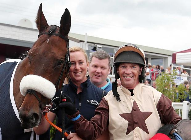 Winner: Cecil Corbett, ridden by Paul Carberry, gave trainer Gordon Elliott (second from right) his solitary victory