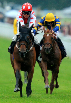 Winner alright: Ulster jockey Sammy Jo Bell rides Imshivalla (left) to victory in the Whiteley Clinic Stakes at Goodwood