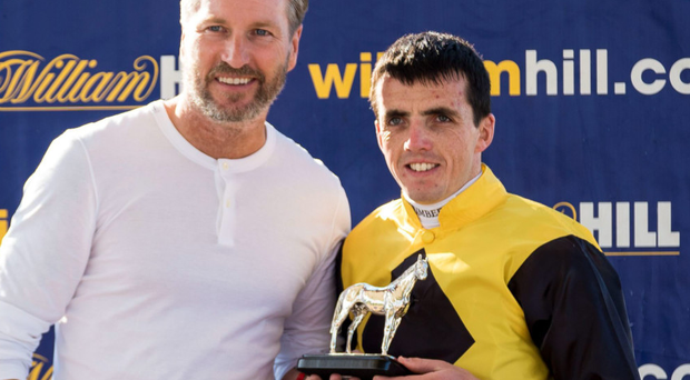 Good Ayr day: Ulster jockey Martin Harley, with football pundit Robbie Savage, after riding Go Far to victory in Ayr Bronze Cup