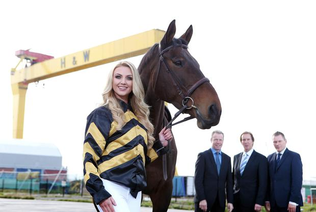Landmark occasion: Meagan Green, along with pundit and Grand National winning jockey Mick Fitzgerald, Down Royal General Manager Mike Todd and Matt Chapman of At The Races, takes the reins at yesterday's launch of the Northern Ireland Festival of Racing which takes place at Down on October 30 and 31