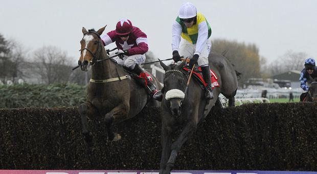 Don Poli (left) comes to collar Many Clouds at Aintree