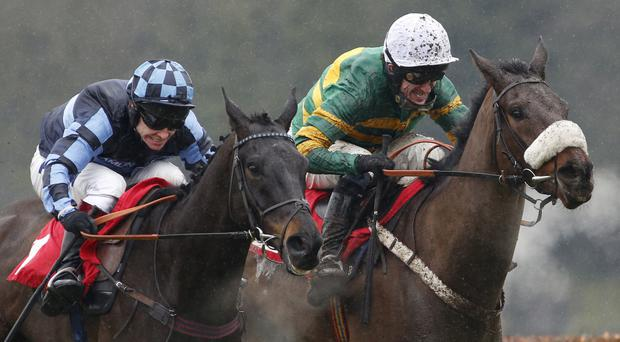 Fierce rivalry: AP McCoy (right) and Richard Johnson battle it out