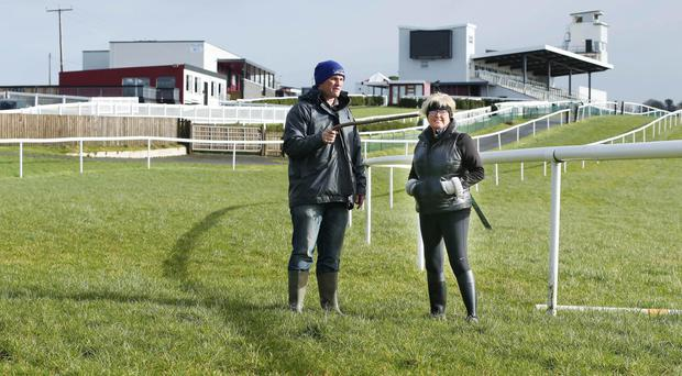 Dampener on day: head groundsman Fintan Ward and Tracey Quail of hospitality after yesterday's Downpatrick meeting was cancelled after 10mm of overnight rainfall