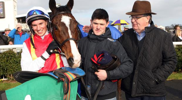Winning combination: Adrian Heskin beams with delight alongside Federici after winning the Ulster Grand National at Downpatrick yesterday