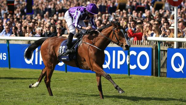 Minding ridden by Ryan Moore wins the QIPCO 1000 Guineas at Newmarket
