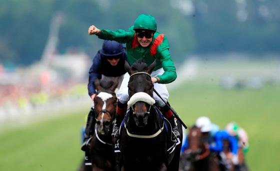 What a feeling: Pat Smullen celebrates Epsom Derby success on Harzand