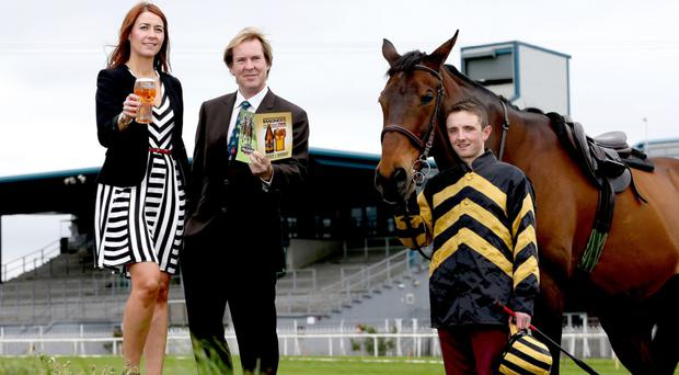 Hat-trick hero: Three times Magners Derby winning jockey Chris Hayes joined Magners Brand Manager Julia Galbraith and Down Royal General Manager Mike Todd to mark the 80th anniversary of tomorrow's Ulster Derby at Down Royal