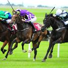 Bocca Baciata (right) pounces at the Curragh