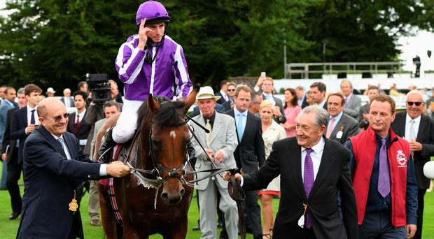 Salute you: Ryan Moore hails the crowd after winning on The Gurkha