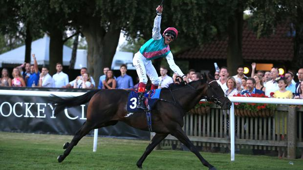 Frankie Dettori celebrates his 3,000th British winner