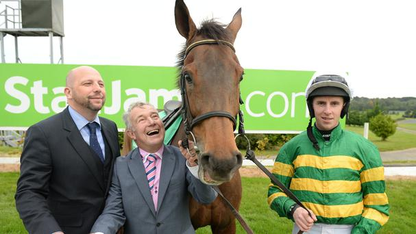 Dual Irish Gold Cup hero Carlingford Lough with Stan James' head of marketing Ed Nicholson (left) trainer John Kiely and jockey Mark Walsh (right). Photo: Cody Glenn/Sportsfile
