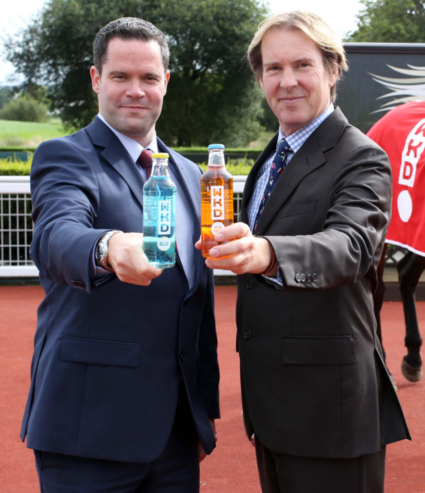 Festival fever: Down Royal General Manager Mike Todd (right) and Brendan Loughran, representing sponsors WKD, toast next month's Festival of Racing