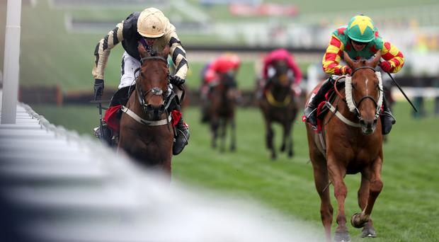 Nichols Canyon (left) zooms along the rail to land the Stayers' Hurdle