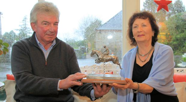 National treasure: Former Irish International showjumpers Leonard and Marion Cave, daughter of Mrs Phyllis McDowell, with the Caughoo Trophy