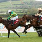Unowhatimeanharry ridden by Noel Fehily (left) goes on to win the Ladbrokes Champion Stayers Hurdle